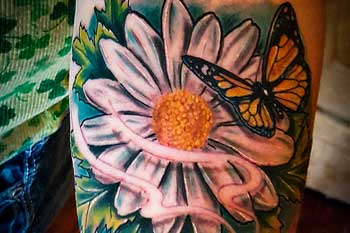 Tattoo of a flower and butterfly