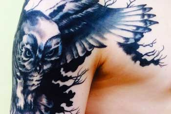 Tattoo of an owl
