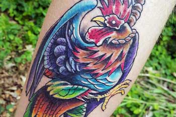 Tattoo of a rooster with a noose