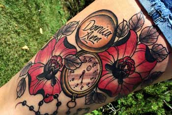 Tattoo of a pocket watch and flowers